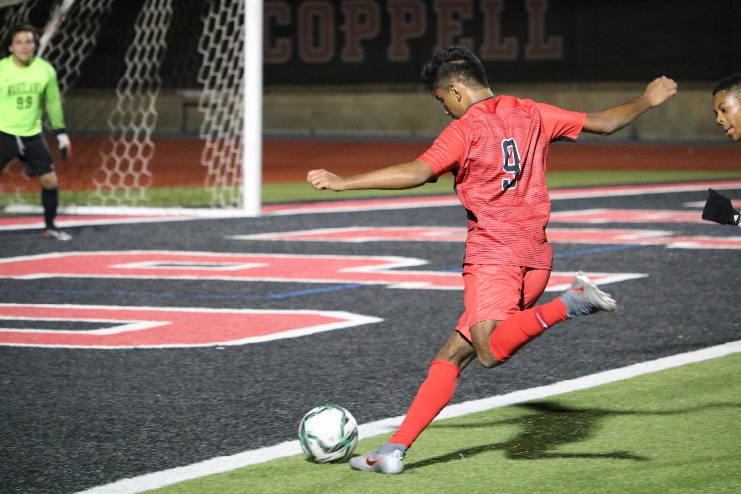 Coppell senior forward Tom Vazhekatt shoots during the scrimmage against Frisco Wakeland on Thursday at Buddy Echols Field. The Cowboys face Frisco Heritage in a scrimmage tomorrow at 7:30 p.m. at Buddy Echols Field.