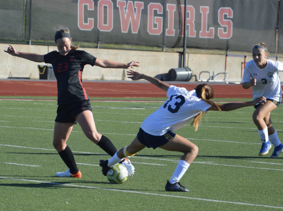 Coppell sophomore defender Bailey Peek steals the ball from a Little Elm midfielder during Saturday's scrimmage at Buddy Echols Field. The Cowgirls tied with the Lady Lobos, 1-1.