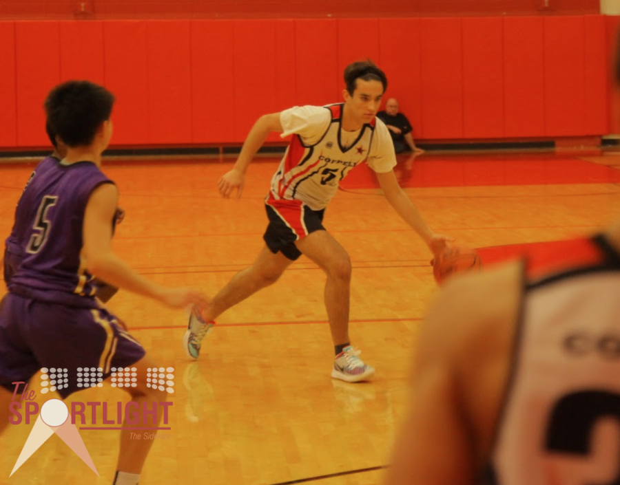 Coppell freshman point guard Pedro Ennes dribbles down the court. Dirk Nowitzki, a former Dallas Mavericks forward, influences how Ennes plays.