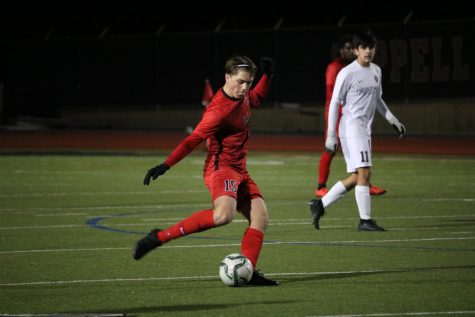 Coppell freshman defender Nicolas Radicic takes a shot during Tuesday's game at Buddy Echols Field. The Cowboys tied 1-1 with Frisco Heritage.