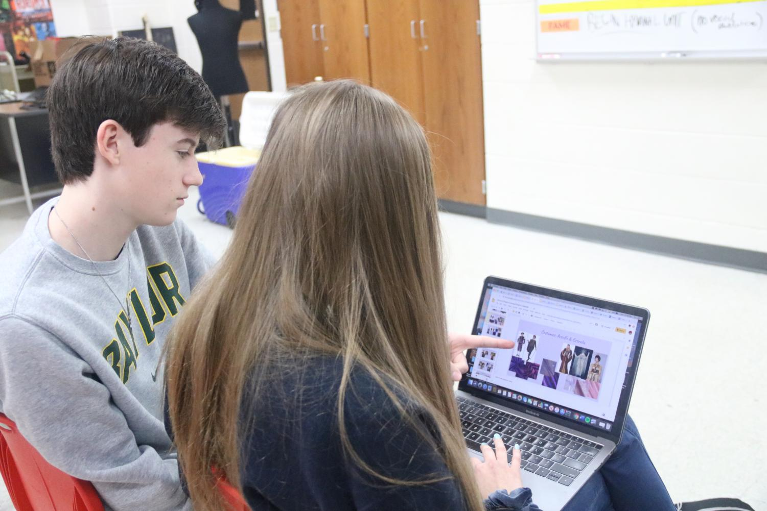 Coppell High School sophomores Will Manchester and Rylie Bonner work on theater project on Wednesday in the CHS theater room. With CHS no longer having semester exams, classes are finishing the grading period with other forms of summative assessments.