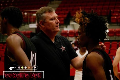 Coppell basketball coach Clint Schnell talks to Mesquite players on Dec. 10 in the CHS Arena following the nondistrict game. Schnell has been the head Coppell boys basketball coach for two years.