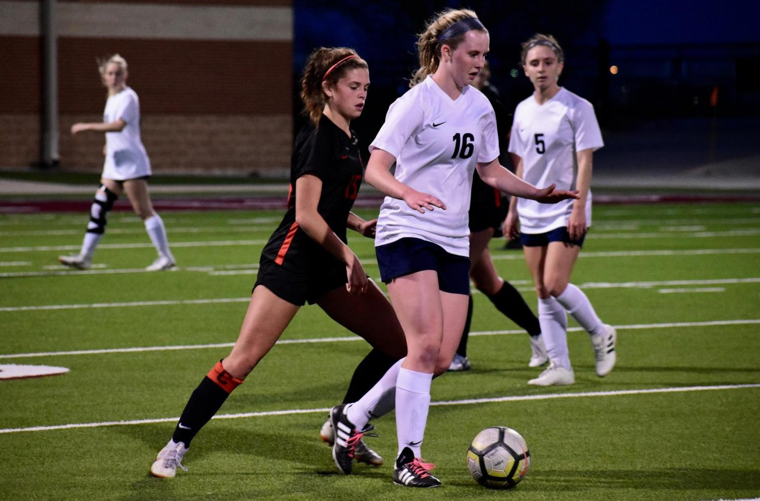 Coppell senior defender Katie Odom attempts to steal from a Keller midfielder last season. The Cowgirls begin their season this Saturday in their first scrimmage.