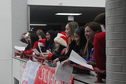 Coppell High School Red Jackets sing Christmas carols on the senior bridge during the passing period before seventh period. Red Jackets Christmas carols are an annual campus tradition where Red Jackets sing for the school to celebrate the holidays.