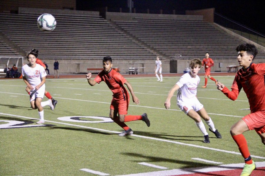 Coppell seniors forward Tom Vazhekatt and midfielder Adam Saif sprint down the line during a scrimmage against Frisco Wakeland at Buddy Echols Field on Dec. 12. The Cowboys resume District 6-6A play at 7:30 p.m. tonight against Herbon.
