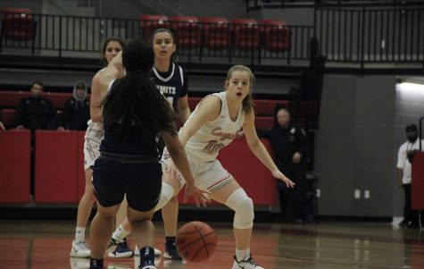 Coppell junior guard Emma Sherrer defends against Irving Nimitz on Friday at the CHS Arena. The Cowgirls face Irving MacArthur tonight at 8 p.m.