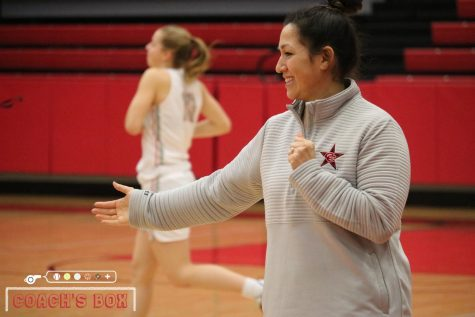 Coppell assistant girls basketball coach Julieann Hartsburg high fives players during the pregame introduction during their District 6-6A game against Irving. Hartsburg previously worked as the street team coordinator for the Dallas Mavericks.