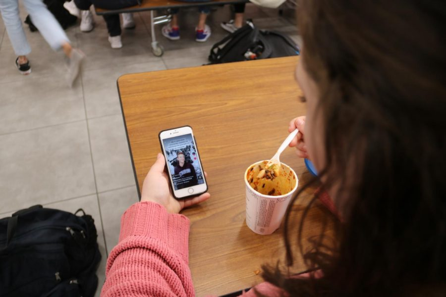 Coppell junior Abby Kadane watches a TikTok about the possibility of World War III during lunch on Monday. Many teenagers respond to the recent events in Iran with online memes, TikToks, and short videos about the risk of a World War.