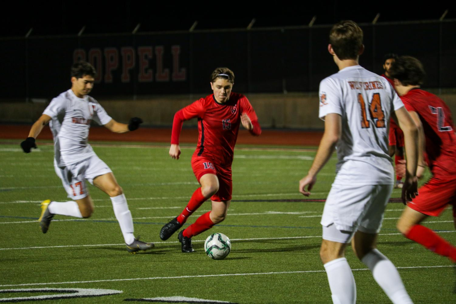 Coppell freshman center midfielder Nicolas Radicic passes during the scrimmage against Frisco Wakeland on Dec. 12 at Buddy Echols Field. After playing soccer for 14 years, Radicic is one of two freshmen on the varsity team.