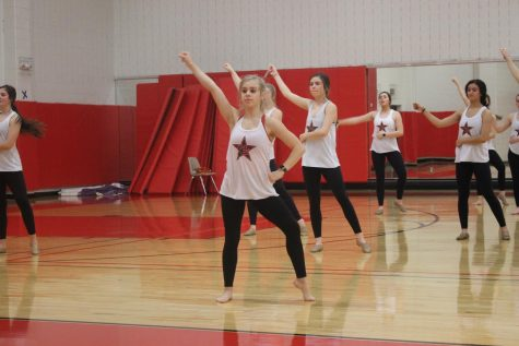 "Coppell High School junior Kennedy McCann practices a contemporary piece with the Lariettes during fifth period on Jan. 17 in the small gym. McCann was in the Netflix show ""Dancing Queen"" with the dance team Beyond Belief."