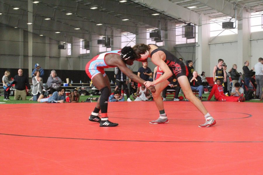 Coppell senior Garrett Hardin wrestles Skyline senior Kundae Ange on Nov. 23 in the CHS Field House for the 138 weight class bout, later losing the bout at the Coppell Round-Up. Coppell is hosting Senior Night against Keller Fossil Ridge in the CHS Arena tomorrow at 6 p.m.