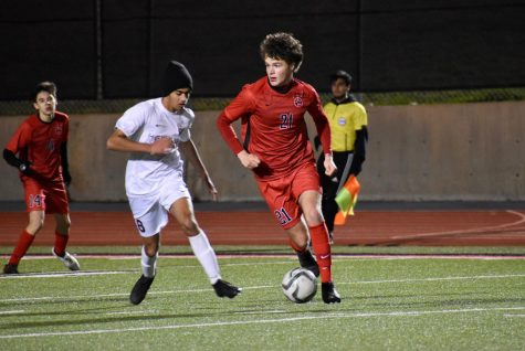 Coppell senior defender Maxwell Winneker watches for an open pass during the scrimmage against Frisco Heritage on Dec. 17 at Buddy Echols Field. The Cowboys play Rockwall-Heath tonight at 7:30 p.m. at Buddy Echols Field for their last preseason match.