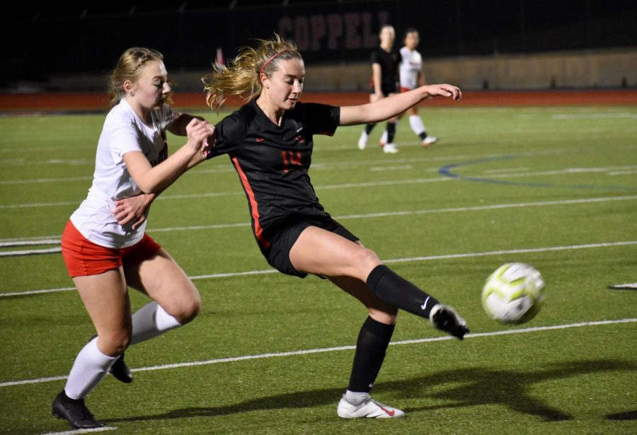 Coppell senior defender Haley Roberson kicks against Irving MacArthur last Friday at Buddy Echols Field. The Cowgirls defeated the Cardinals, 5-1.