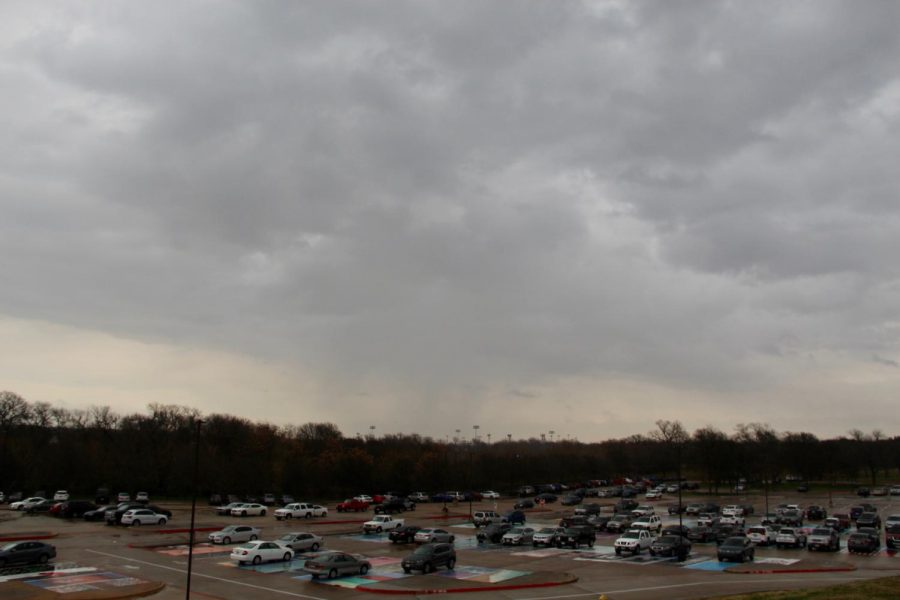 Dark clouds surround Coppell High School this afternoon during fourth period near the senior parking lot. Several events throughout the day have been canceled due to impending inclement weather.