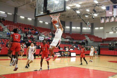 Basketball conquers the Cardinals 69-58
