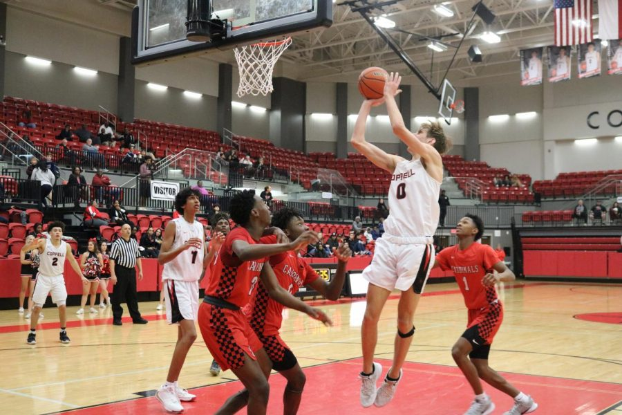 Coppell+High+School+senior+forward+Clayton+Hunter+goes+up+to+shoot+against+Irving+MacArthur+in+the+CHS+Arena.+Coppell+defeated+the+Cardinals%2C+69-58%2C+last+night.