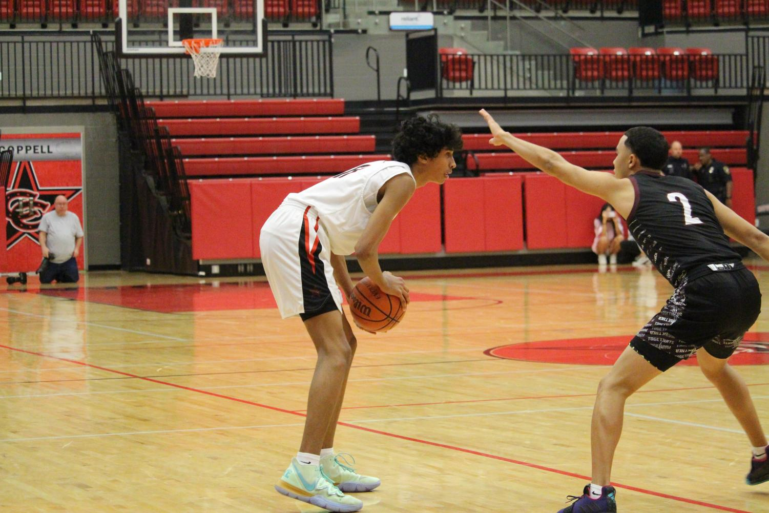 Coppell sophomore guard Ryan Agarwal attempts to make a play in the CHS Arena earlier this season against Timber Creek. The Cowboys play Irving tomorrow in the CHS Arena at 8 p.m.