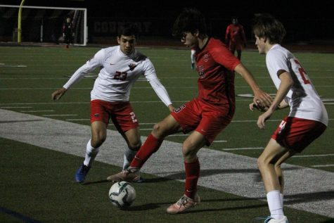 Coppell freshman forward Preston Taylor takes possession of a throw-in against Rockwall-Heath yesterday at Buddy Echols Field. The Cowboys defeated the Hawks, 2-0, in their final preseason match.