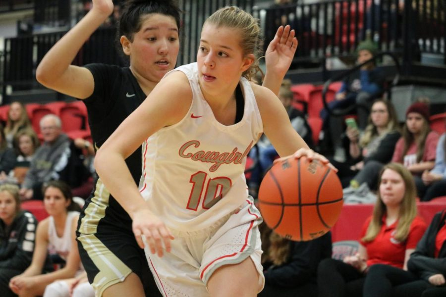 Cowgirls tame Tigers after shaky district start