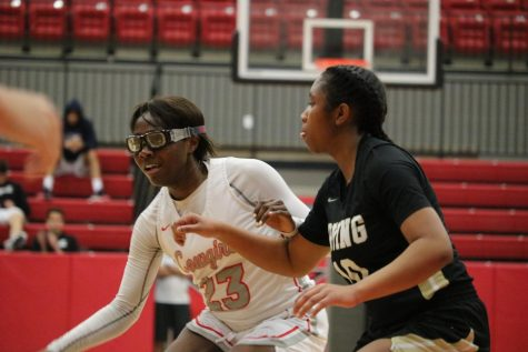 Coppell senior guard Nicole Obialo shields against Irving sophomore guard Ra'Nyi Patterson on Saturday in the CHS Arena. The Cowgirls face Irving Nimitz tomorrow in the CHS Arena at 6:30 p.m.