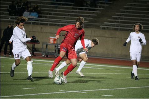 Coppell senior midfielder Sebastian Blaas shields against Frisco Heritage defenders during the scrimmage on Dec. 17 at Buddy Echols Field. Blaas's club soccer team, Solar 02B, won the U.S. National Youth Soccer Championship nationals during the summer.