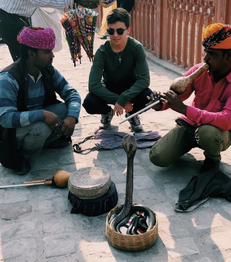 Coppell High School senior Santiago Ceniceros interacts with snake charmers in Jaipur, India. Ceniceros has a passion for broadening his world view and learning more about cultures through travel. Photo courtesy Santiago Ceniceros