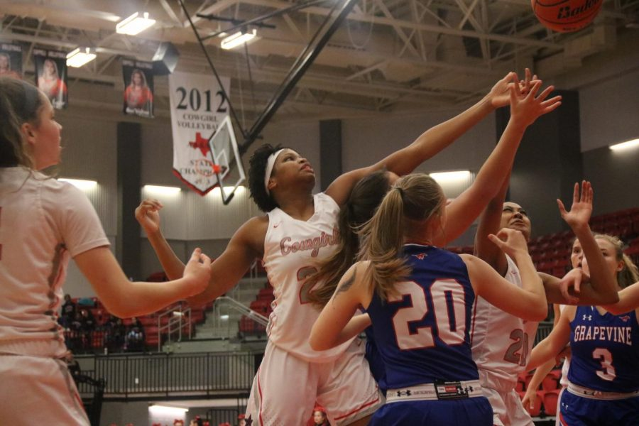 Coppell senior guard Nicole Obialo reaches for a rebound against a Grapevine defender in the CHS Arena on Dec. 10. The Cowgirls play Irving in their fifth District 6-6A game tomorrow at 6:30 p.m. in the CHS Arena.