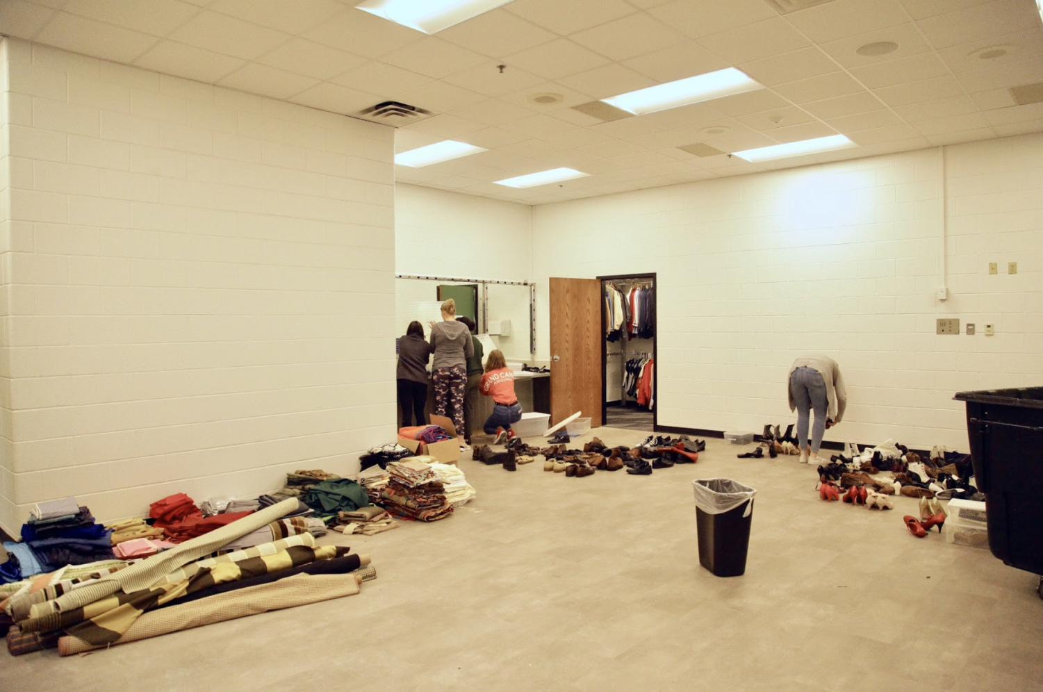 Students organize the Coppell High School green room during Karen Ruth's second period Studio Premier theater class on Thursday. The green room recently finished undergoing renovations.