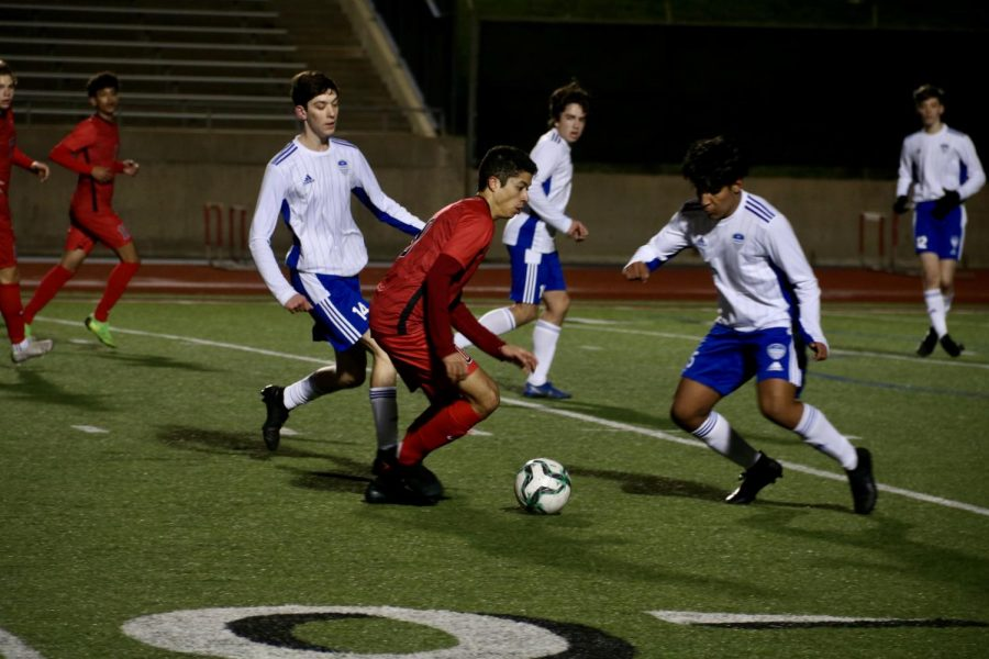 The Cowboys lost to the Hawks, 1-3, in their first district 6-6A home match. Coppell senior midfielder Caleb Razo dribbles against Hebron on Tuesday at Buddy Echols Field.