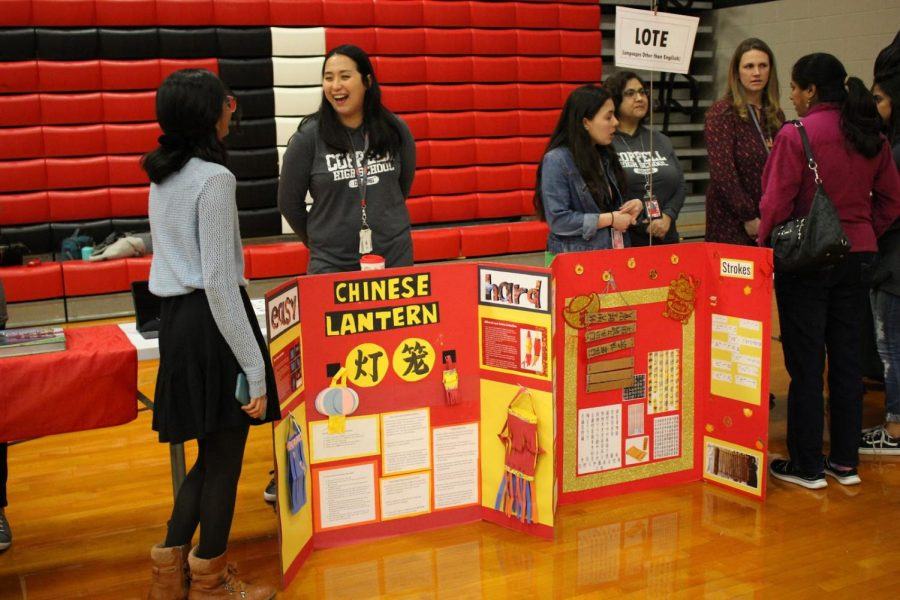 Languages+Other+Than+English+%28LOTE%29+teachers+display+triboards+about+the+Chinese+culture+in+the+Coppell+High+School+main+gym+on+Tuesday.+Teachers+were+stationed+throughout+the+gym%2C+cafeteria+and+commons+for+the+spring+showcase%2C+which+gave+incoming+students+the+opportunity+to+inquire+about+courses+for+the+2020-2021+school+year.