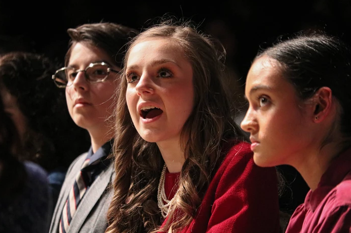 """Coppell High School junior Sydney De León (Juror 4), sophomore Rylie Bonner (Juror 3) and sophomore Sneha Kumar (Juror 2) act in """"12 Angry Jurors"""" in the CHS Black Box on Friday. The production, student-directed by New Tech @ Coppell junior Isabella Enriquez, follows 12 jurors as they deliberate on the sentencing of a murder case."""