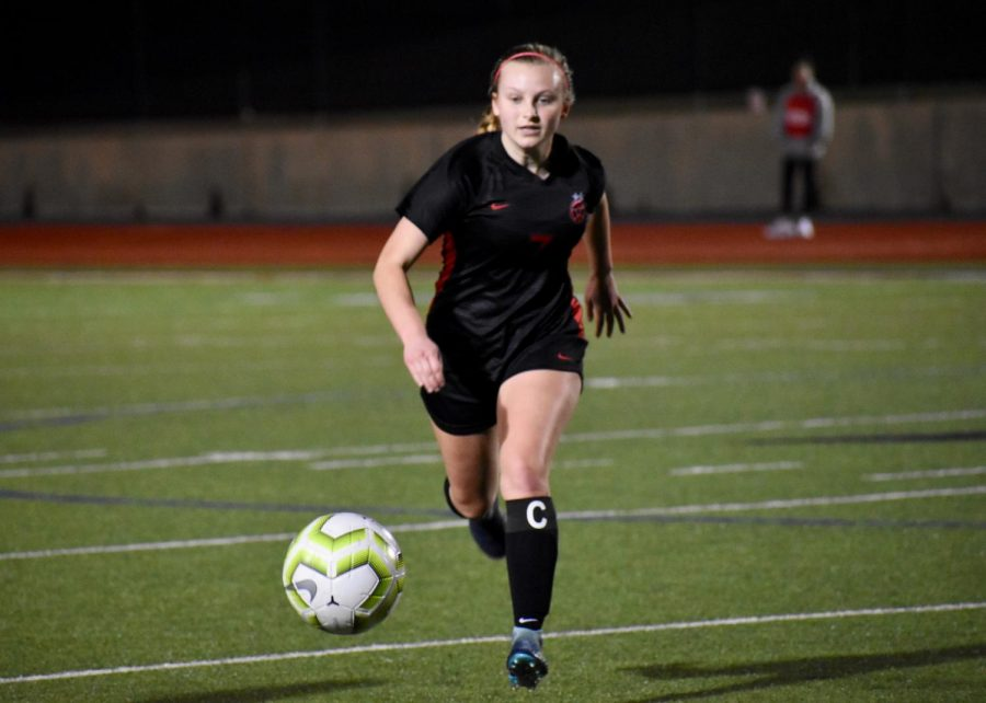 Coppell senior forward Alyssa Roemer keeps possession against Irving MacArthur on Jan. 24 at Buddy Echols Field. The Cowgirls face Lewisville tomorrow at 7:30 at Buddy Echols Field.