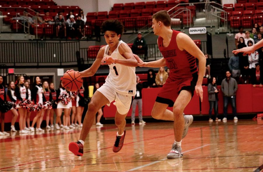 Coppell sophomore guard Anthony Black dashes up the court alongside Marcus senior forward Ben Joelson on Jan. 31 in the CHS Arena. The Cowboys face Hebron tonight at 8 p.m. in the CHS Arena.