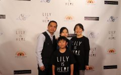 Producer Danny Aguliar, his wife Keiko Aguilar, his daughter Sidekick staff designer Kaylee Aguilar and his son Daniel Aguilar smile excitedly during the red carpet movie premiere for Lily Is Here at the Angelika Film Center at Mockingbird Station in Dallas on Monday. Lily Is Here is an indie film about opioid abuse and the relationships shared between people.