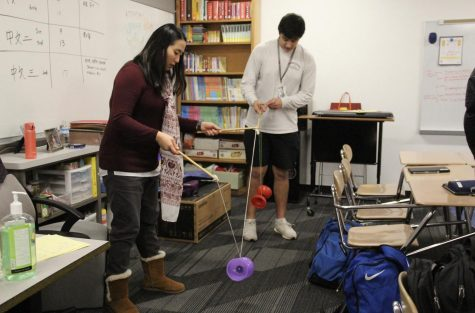 Coppell High School Mandarin Chinese teacher Andrea Voelker instructs junior Shoy Border how to play Chinese yoyo during third period on Jan. 23.