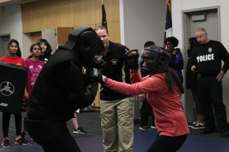 Coppell High School senior Michelle Moller presents her one-on-one fight practice test against Officer Tonard Warmsley during self-defense class on Feb. 18. The class is every Tuesday from 6-8 p.m. at the Coppell Police Department.