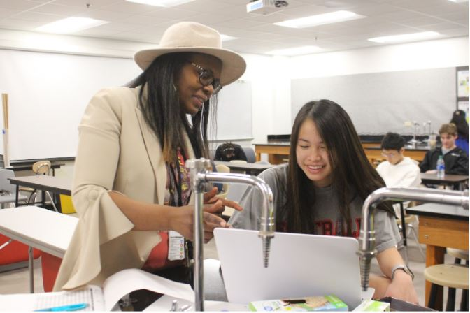 Coppell Forensic and Earth and Space Science teacher Lanissa Spear works with senior Nawawan (June) Poopanead during third period on Friday. Spear is an experienced teacher who came to Coppell from Chicago.
