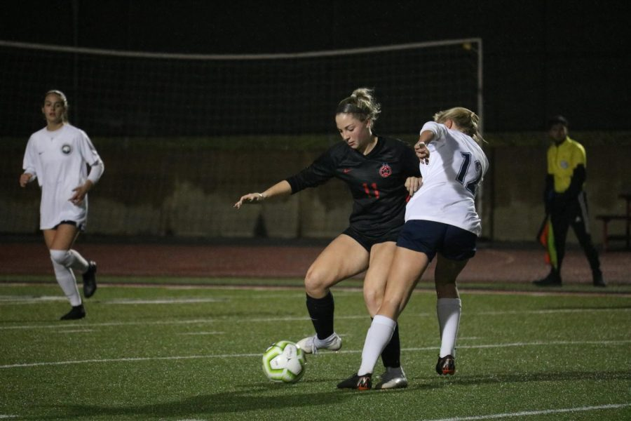 Coppell+junior+defender+Emma+Hubert+fights+for+possession+from+Flower+Mound+senior+midfielder+Caitlin+Matthews+on+Friday+at+Buddy+Echols+Field.+The+Cowgirls+fell+to+Flower+Mound%2C+1-0.+