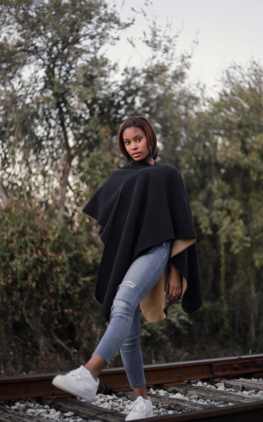 Coppell High School junior Hailey Wilkins models on a railroad in Coppell on Nov. 15. Wilkins uses the history of black models and fashion as an inspiration for her modelling journey.