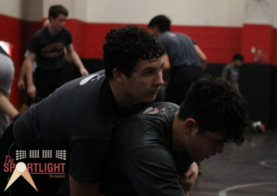 The Sportlight: Manning using interests in wrestling, football to propel athletic journey