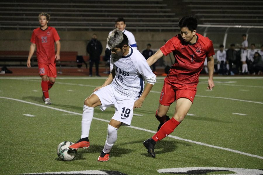 Irving+Nimitz%E2%80%99s+Jonathan+Morales+dribbles+away+from+Coppell+senior+midfielder+Ben+Wang+last+night+at+Buddy+Echols+Field.+Nimitz+came+back+from+a+two-goal+deficit+to+defeat+the+Cowboys%2C+3-2.