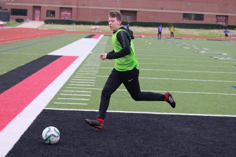 Coppell junior JV forward Ilhan Muslija dribbles during practice on Thursday at Buddy Echols Field. Muslija made the first cut for the U19 Bosnian national team and hopes to play soccer in college.