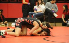 Coppell freshman Scout Carrell tackles Huitron Genesis from Keller Fossil Ridge on Jan. 30 at the CHS Arena. Four girls and one boy from the Coppell wrestling team advanced to the UIL State Championships on Feb. 21-22 in Houston.