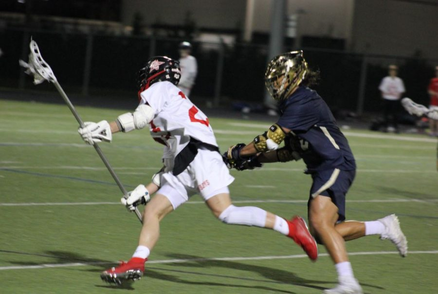 Coppell junior Colton Delk runs past Jesuit defenders last season at CHS9. Coppell faces Kingwood tomorrow at Coppell Middle School North at 3 p.m.