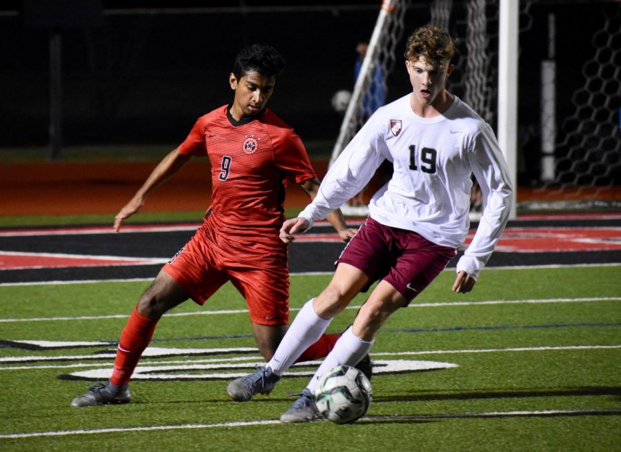 Coppell+senior+forward+Tom+Vazhekatt+looks+to+tackle+Lewisville+junior+midfielder+Brody+Webster+against+Hebron+on+Jan.+28+at+Buddy+Echols+Field.+The+Cowboysplay+MacArthur+at+7%3A30+p.m.+tonight+at+Buddy+Echols+Field.