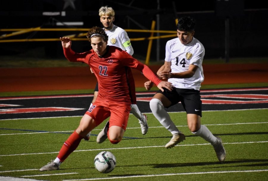 Coppell senior midfielder Sebastian Blaas makes a tackle from Irving's Elian Valerino against Irving on Feb. 7 at Buddy Echols Field. The Cowboys lost, 2-1, to the Tigers and play Irving Nimitz tonight at 7:30 p.m. at home.