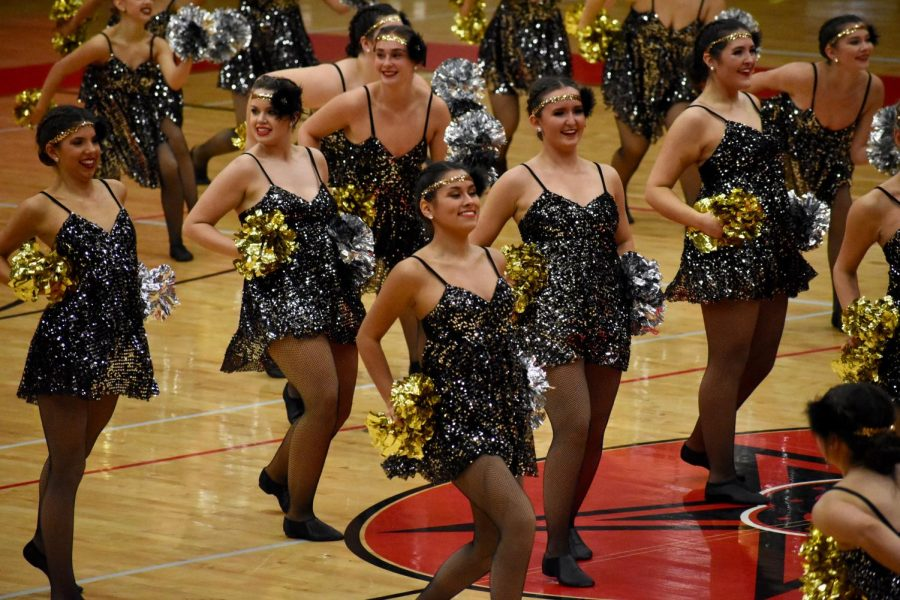 The Coppell High School Lariettes perform their team pom dance at the Lariette Showoffs on Feb. 12 in the CHS Arena. The Lariettes hosted their annual showoffs performance as a preview to their upcoming competition season.