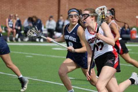 Coppell High School junior midfielder Ella Jenkins runs downfield. The Cowgirls lost to the Flower Mound Jaguars, 13- 4 on Saturday at Coppell Middle School North.