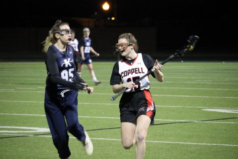 Coppell sophomore midfielder Sadie Harp tries to get past Keller sophomore midfielder  Sarah Spera. The Cowgirls lost to the Indians,15-7, on Thursday at Coppell Middle School North.