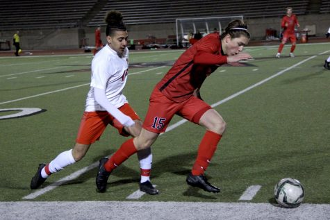 Coppell freshman midfielder Nicolas Radicic heads upfield at Buddy Echols Field on Friday against MacArthur. Coppell defeated the Cardinals, 2-1.